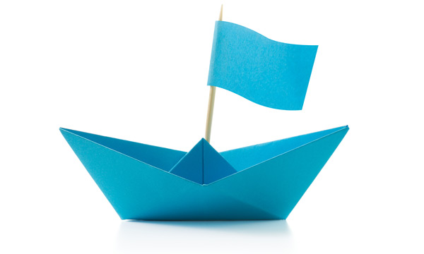Single blue origami boat